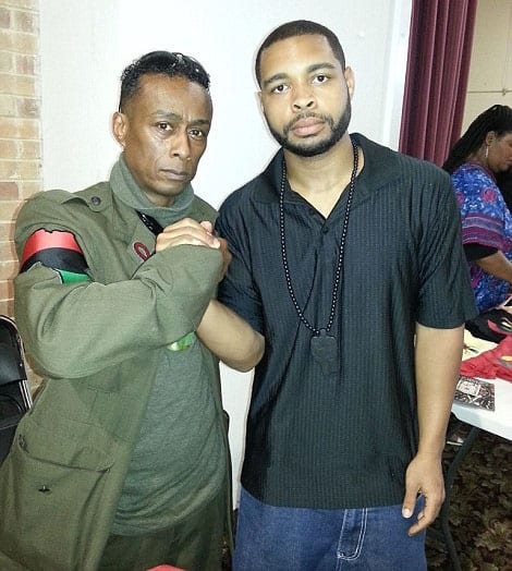 """Micah Johnson with """"Professor Griff"""" of the hip hop group Public Enemy. The group was known for its politically-charged lyrics. Its album Fear of a Black Planet critiqued """"institutional racism"""" and """"white supremacy"""" and called for black power."""
