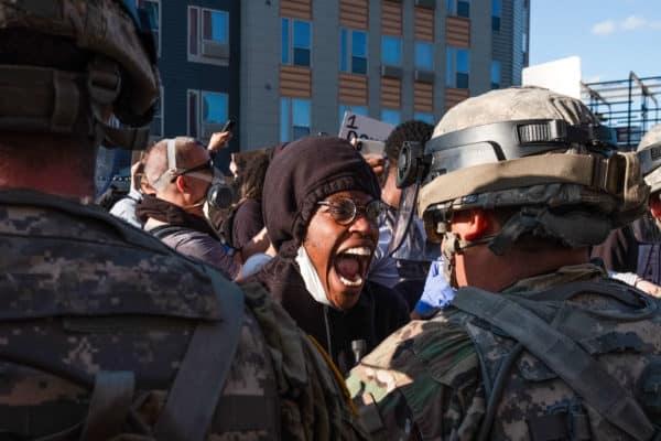 Black Man Yelling at National Guard