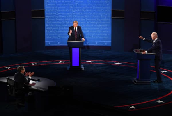 President Donald J. Trump (C) and Democratic presidential nominee former United States Vice President Joe Biden (R), with Chris Wallace moderating, face off in the first of three scheduled 90 minute presidential debates, in Cleveland, Ohio, on Tuesday, September 29, 2020 (Credit Image: © Kevin Dietsch / POOL / CNP via ZUMA Wire)