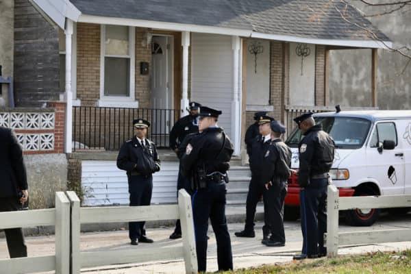 Philadelphia police wait outside a row house in West Philadelphia, the site of a multiple homicide, on Nov. 19, 2018. (Credit Image: © TNS via ZUMA Wire)