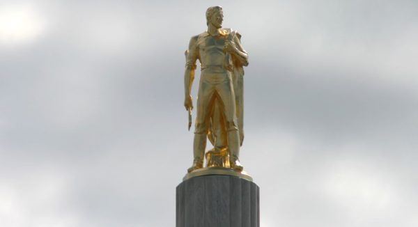 The Oregon Pioneer sculpture that sits atop Oregon State Capitol building in Salem. (Credit Image: Andrew Nealon via Wikimedia)