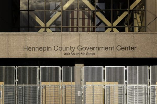 Fencing erected around the Hennepin County Government Center in preparation for the trial of Derek Chauvin. (Credit Image: Lorie Shaull via Wikipedia)