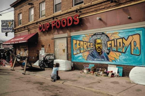 Kneeling at the George Floyd Mural